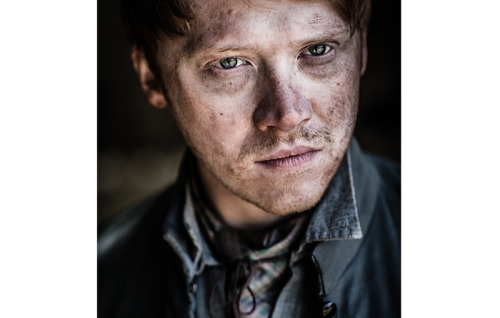 We have an amazing treat for all Rupert Grint fans tonight. Thanks to Anonymous (we would love to know your name, so we can give proper credit…), we have this amazing picture to share with you guys. This amazing picture was taken by photographer Tim Booth and you can see a larger version of the image in our gallery here. We don't know what the purpose of this photoshoot is, but we will investigate and update with further information and more pictures if they are unvcovered. How do you like the look of this new photoshoot? UPDATE: We now have more details about the Tim Booth picture, and it is extremely interesting. On May 1st, Tim updated his blog with the following quote:  Spent the day shooting stills on the set of Instruments of Darkness, which was a chapter for the film Enemy of Man directed by Vincent Regan. This one is of Jason Flemyng letting rip in a fight sequence, all swords, clashing armour and fire, very dramatic. I also got some nice shots of Charles Dance and Rupert Grint. Good day, nice people and rather fun.   http://www.rupert-grint.us/wordpress/2013/05/09/rupert-grint-new-photoshoot-image-by-tim-booth/