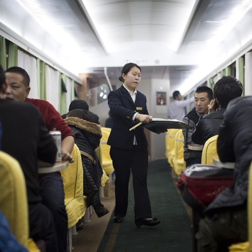 The dinning car on the train from Changsha to HuaiHua in China, January 12, 2013. (John Lehmann/The Globe and Mail) Follow @johnlehmann for more during his trip through China. #china #mao #photojournalism