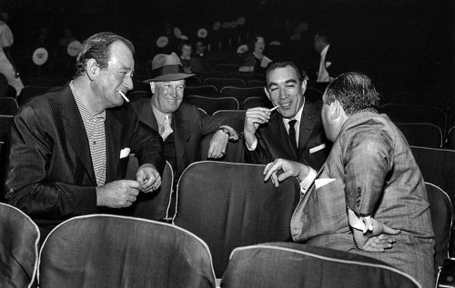 From the Archives (March 26, 1958): From left, John Wayne, Maurice Chevalier and Anthony Quinn share a laugh with producer Jerry Wald at rehearsals for the Academy Awards. Click here for more vintage Academy Award photos  Photo: Los Angeles Times