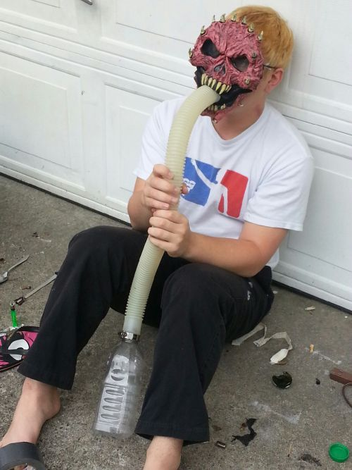 Homemade gas mask. Took about 45 mins to make. Smokes like a champ. I know the outside doesn't look like it would work but when you see the way the inside is rigged you would see how it does. :)