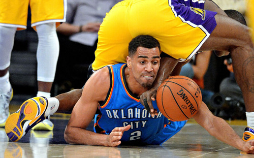 "OKC's Thabo Sefolosha gives new meaning to having the ""World"" on his shoulders. hoopdiary.com"