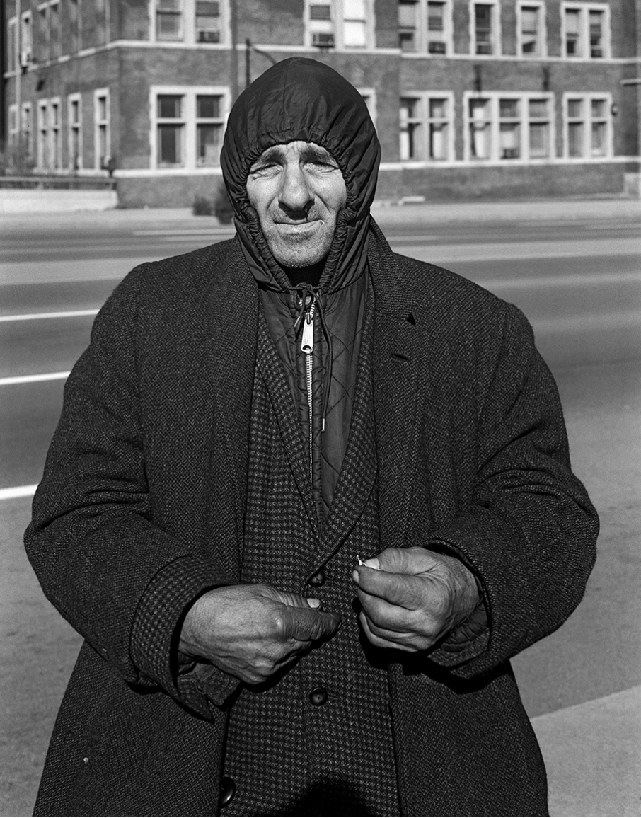 mpdrolet:  A man wearing several coats, holding a piece of paper, Detroit, MI, November, 1973 Dave Jordano