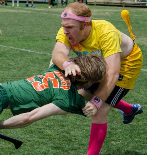 "blitzdrwg:  myquidditchlife:  One of my favorite pics of me from World Cup.  Yes, I know the angle of the shot makes it look a little awkward.  But this captures one of the most intense moments of my weekend, where I went against one of the best seekers in the sport and held my own.  After this game, I just went back to the snitch tent and collapsed.   David is just like ""Fuck my life."""