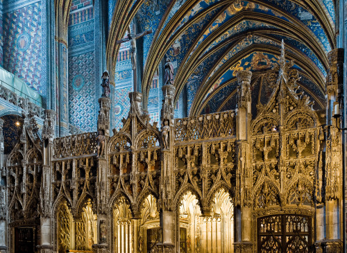 The stunning choir screen and Great Rood of the Cathedral of Saint Cecilia in Albi, France, seat of the Archbishop of Albi-Castres-Lavaur. The rather squat, dull exterior—Albi Cathedral was originall built as a fortress—belies a truly sumptuous interior bathed in rich blues.