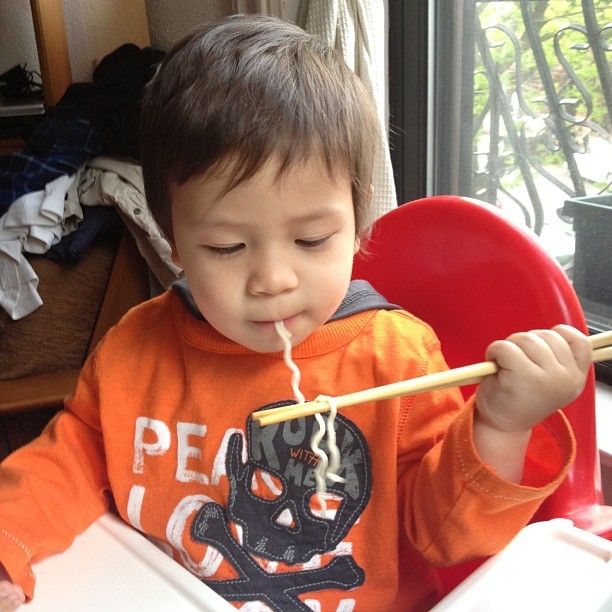 "For mama's birthday, baby ""learns"" to eat with chopsticks 🍜"