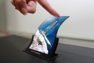 LG showing off 5 inch flexible screen for smartphones. LG will be showing off their latest flexible and unbreakable 5 inch OLED display at this weeks SID display week in Vancouver. The plastic display will be shown off alongside other 5 inch and 7 inch HD Oxide TFT panels which have a bezel that's only 1mm wide, allowing for smartphones and small tablets with virtually no frame or border.