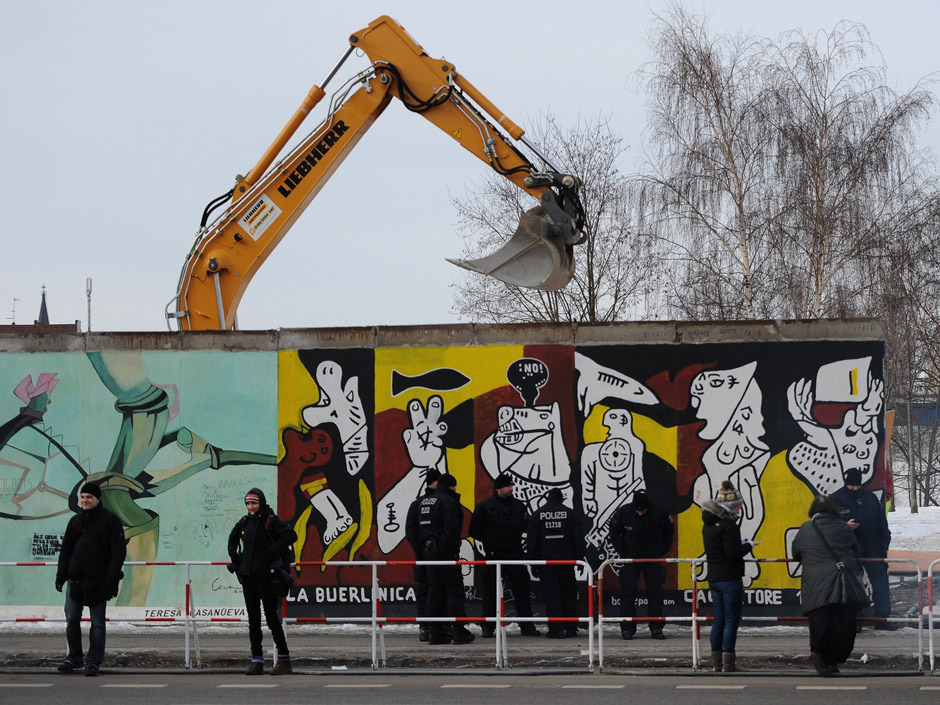 "nationalpost:  Fury as workers remove parts of Berlin Wall's longest remaining stretch for upscale building projectWork crews backed by about 250 police removed parts of the Berlin Wall known as the East Side Gallery before dawn Wednesday to make way for an upscale building project, despite demands by protesters that the site be preserved.Residents of the area expressed shock at the move, which followed several protests including one attended by David Hasselhoff.By mid-morning the six-yard (meter) gap was covered by a wooden fence and protected by scores of police. Passers-by and a handful of protesters stared in disbelief.""If you take these parts of the Wall away, you take away the soul of the city,"" said Ivan McClostney, 32, who moved here a year ago from Ireland. ""This way, you make it like every other city. It's so sad."" (Britta Pedersen / The Associated Press)"