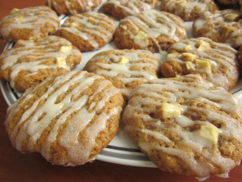 Glazed Apple Cookies Cookie Ingredients: · 1 stick butter, softened · 1 1/3 cups brown sugar · 1 egg · 2 cups all-purpose flour · 1 tsp baking soda · ½ tsp salt · 1 1/2 tsp ground cinnamon · 1 cup diced apples · 1/4 cup milk Glaze Igredients: · 1 cup powdered sugar · 1 tbsp butter · ½ tsp vanilla extract · 2 ½ tbsp. heavy cream Instructions: 1. Peel and dice apple. 2. Cream together butter and brown sugar until light and fluffy. 3. Beat in egg and milk and mix thoroughly. 4. In a separate bowl, stir together flour, baking soda, salt, and cinnamon. 5. Add diced apple to dry ingredients. 6. Sift dry ingredients into wet. 7. Form cookies on greased baking sheet and bake at 375 F for 8 minutes. 8. While cookies are baking, make glaze. 9. Cream softened butter very well first, then add in vanilla and mix. 10. Sift in powdered sugar and blend together. 11. Add in heavy cream until glaze is at desired consistency. 12. Pipe glaze across cookies while still slightly warm. —— Batch one: (forgot milk)  Batch two: (milk added)   Tips: · The glaze will be thinner the warmer the cookies are. · I accidentally made a first batch of cookies without adding milk to the batter, and they came out okay. Perhaps lessen the amount of milk added to the batter, since it changes the final appearance and adds in little bubbles to the dough. · You can try sprinkling a bit of cinnamon onto the glaze for aesthetic purposes.