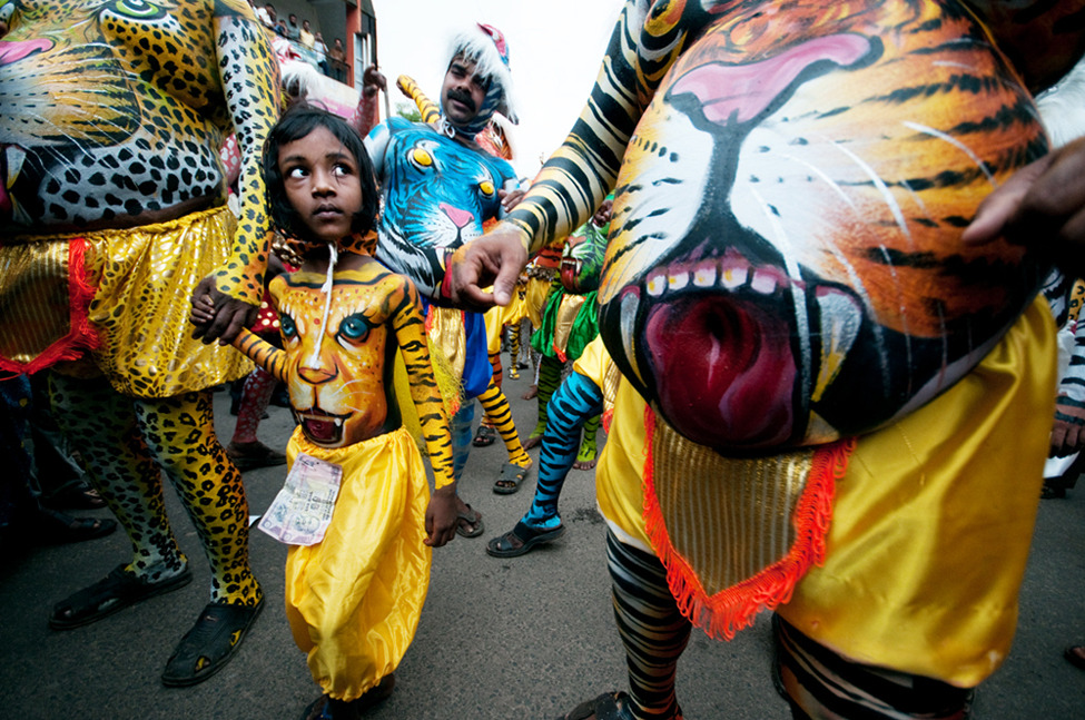 "Photo of the Day: ""Puli Kali""- In the annual festival""Onam."" Held in Kerala, India, this event marked the driving away the evil spirit from society.""Puli"" means tiger and ""Kali"" means dance in malayalam language. Hundreds of people in their tiger make up dance together.""  Photo by: Indranil Sengupta (Hooghly, India); Thrissur, Kerala, India"
