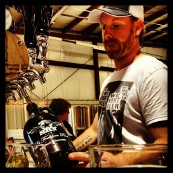 Jeff Cogbill fills growlers like a boss.  (at American Sky Brewing)