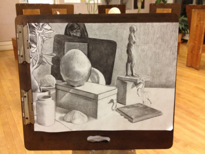 I've been working on this still life in charcoal (not my medium of choice) with my afternoon drawing studio students. Almost done.