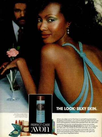 Iman in a 1976 Avon advertisement. She is wearing a dress by Giorgio Sant' Angelo.