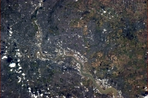 colchrishadfield:  London, England, from Canary Wharf to The City. Look closely and you can see the bridges over the Thames.