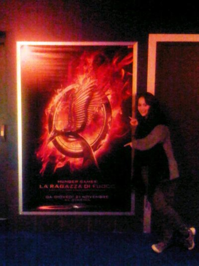 "inmycocoon:  The quality is CRAP, but look what I found at the cinema tonight?? *-*Don't look at me, it seems like I'm homeless lol(In case someone is wondering, in Italy it's called ""The Hunger games: The girl on fire"")"