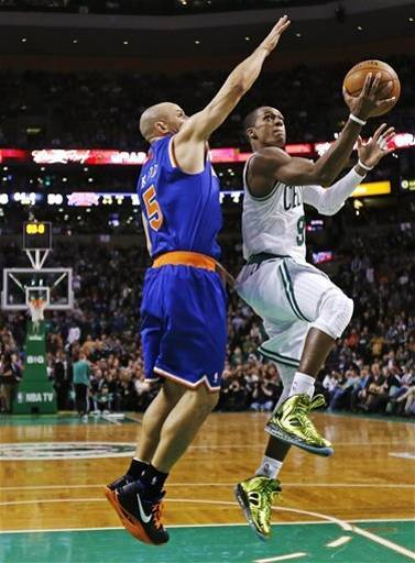 At the last moment, Rondo twisted away from the open layup and fired a behind-the-back bounce pass to Jeff Green, who bricked a contested 18-footer. (Rajon Rondo notched his 27th career triple-double tonight.) (AP Photo/Charles Krupa)