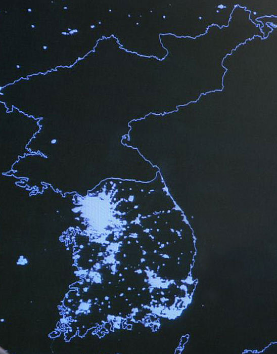 North Korea at night. The capital city of Pyongyang appears as the only blip of light amidst the sea of darkness.