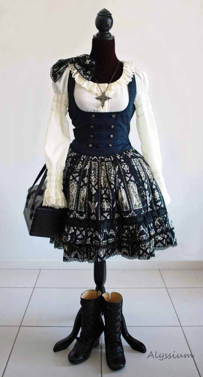 alyssiumbaby:   Alice and the Pirates Crepe Blouse Innocent World Marguerite Bustier and Gretel boots in black Baby the Stars Shine Bright Love Moon Princess Stained Angel Print Skirt  and hand bag Moi Meme Moitie Cross Necklace