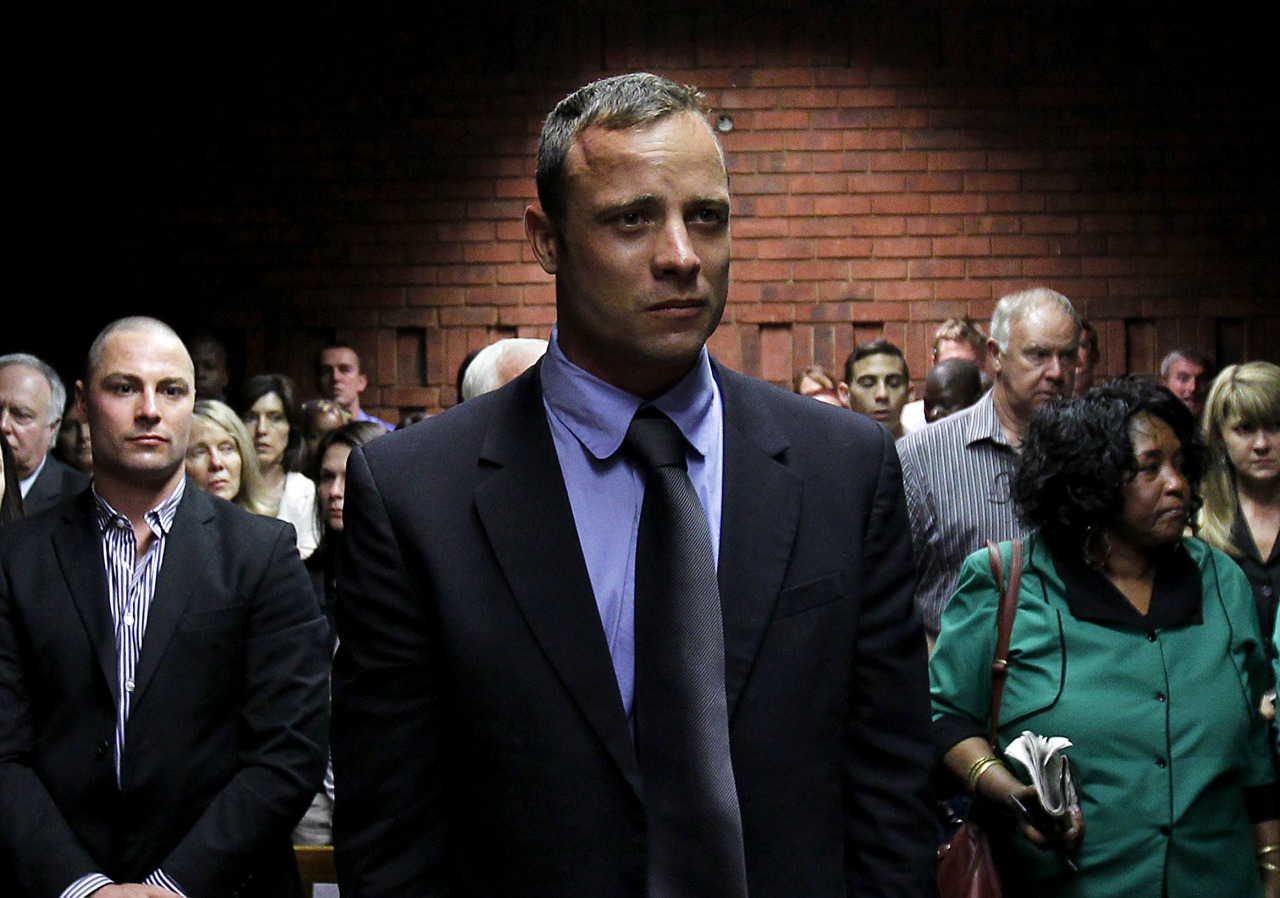 """Blade Runner"" Oscar Pistorius put on his artificial legs and walked across his bedroom before firing four shots through a locked toilet door, killing his cowering girlfriend in cold blood, prosecutors said on Tuesday. Reeva Steenkamp, a 30-year-old law graduate and model, died after being hit by three rounds from a 9-mm pistol, prosecutor Gerrie Nel said. Pistorius, 26, wept uncontrollably in court as Nel outlined details of a shooting that has stunned South Africa and the millions around the world who saw the double amputee's track glory as an inspiring tale of triumph over adversity. Later, in a dramatic affidavit read out by defense lawyer Barry Roux, Pistorius said he had been ""deeply in love"" with Steenkamp, whom he had been dating since November, and had no intention of killing her. READ ON: Pistorius shot girlfriend through door: prosecutor"