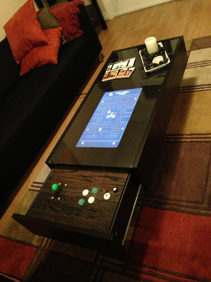 Ikea Coffee Table Arcade Instructables user hoogen tricked out his Ikea Ramvik coffee into a super sweet arcade machine using a 60-in-1 iCade Classic Multigame JAMMA board. If Don Draper had an arcade coffee table, this would be it. Check out a video of the buttery smooth arcade stick drawer in action below.