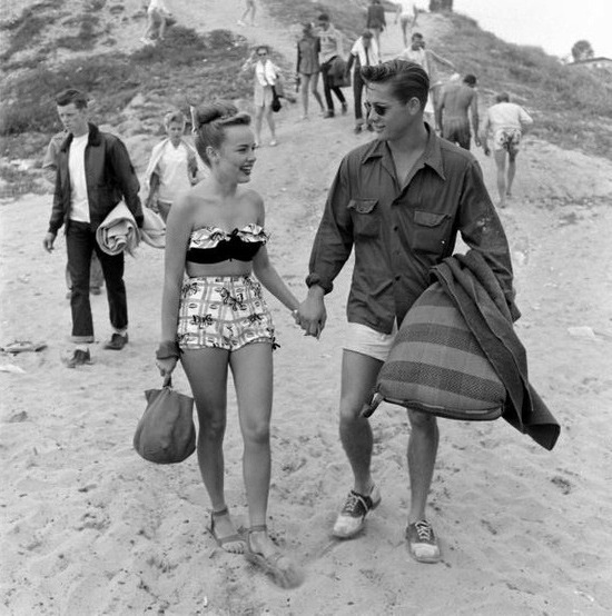 Beach date, 1950s  this is so unbelievably perfect. New favorite picture ever.  This picture is so wonderful aw  WHY CAN'T GUYS DRESS LIKE THIS NOW STUPID BAGGY SHORTS, STUPID TACKY HOODIES, STUPID SNAPBACKS   Guys do dress like this now-a-days. You might know them better as hipsters, or as classy mother fuckers.