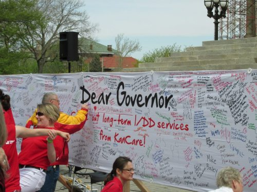 """More than a thousand disabled Kansans and their families staged a protest on the capital steps. Advocates say the state's new long-term care plan for intellectually and developmentally disabled residents will jeopardize their well-being. Under the plan, called KanCare, three private insurance companies will dictate long-term coverage for the developmentally disabled beginning Jan. 1, 2014."" (Full story here.)  Photos via The Arc of Sedgwick County."