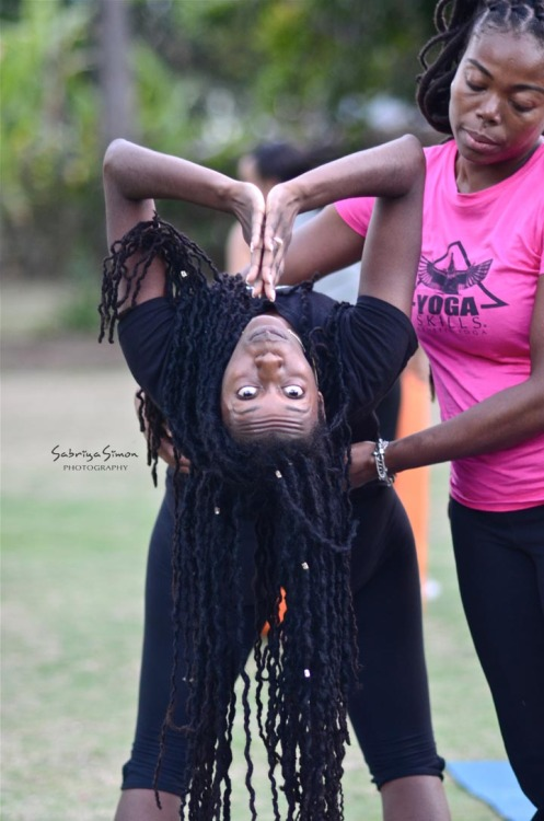 "~Support~ Certified Kemetic Yoga Instructor, Latoya Bridgewater assisting another yogini into Wheel Pose from standing position. Wheel Pose ""is pictured prominently on the walls of temples and tombs in ancient Kemet."" ~ Yirser Ra Hotep.  {Image taken during the 'SOUL YOGA FEST' held at the Hope Botanical Gardens in Kingston, Jamaica by Master Kemetic Yoga Teacher, Yirser Ra Hotep.}"