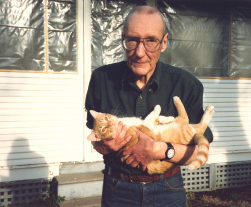 William Burroughs holding Ginger