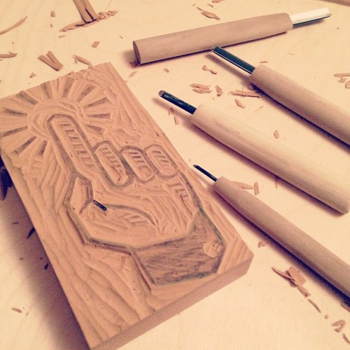 Trying my hand at some linoleum carving.