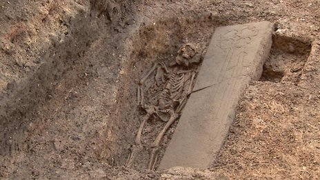 breakingnews:  Medieval knight found beneath a Scottish parking lot TIME: The tomb of a medieval nobleman that was discovered during building work at a Scottish parking lot will likely be moved to make way for a new environmental development, the BBC reports.  The ornately carved grave was found amid the ruins of a 13th century monastery in the Old Town area of Edinburgh. The site has been earmarked for a rainwater-harvesting tank for the city's new Centre for Carbon Innovation.  Photo: Grave of a medieval knight that has been discovered under an old city car park in Edinburgh.