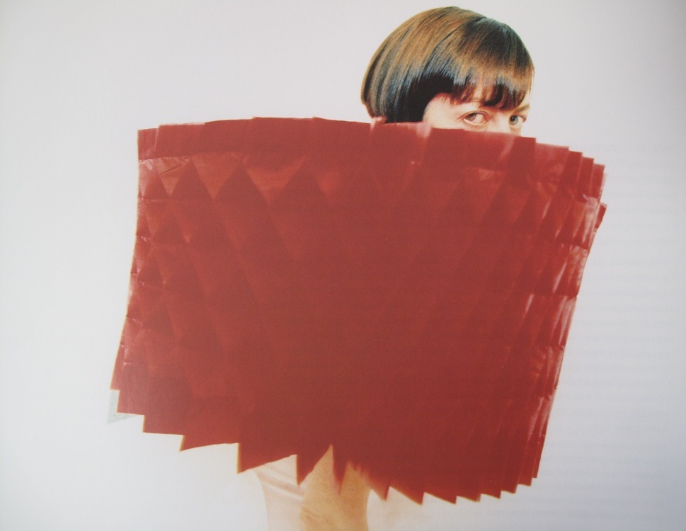 endthymes:  from hiroaki ohya's 1999 fashion project—books open into garments: intricately folded red polyester 'published' in 21 volumes