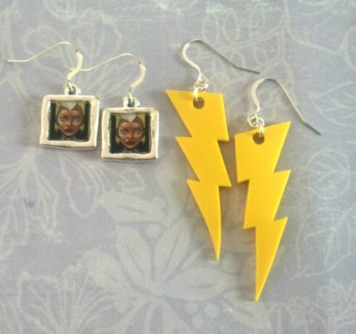 optimysticals:  New Products: Mohawk Storm and Lightning Bolt Earrings Mohawk Storm? The answer is always yes! These are on their way to St. Louis Comicon with us, but should they still be without a home by the time we get back they'll be making their way to our website. If you want to give them a home. Let us know by email (wonderwoman@optimysticalstudios.com) or by ASK.  YES!!
