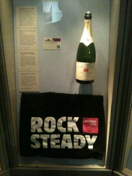 A T-Shirt I wrote about in The Guardian is being displayed in the British Museum for the next six months. I wore it in 2007 to support my mum, who worked at Northern Rock at the time. Lots of people wore them, not realising T-Shirts probably wouldn't be enough to prevent the economic collapse still to come. The exhibition is called Bubbles & Bankruptcy and the champagne bottle on display belongs to my mum - they were given to Northern Rock workers to celebrate demutualisation in 1997.