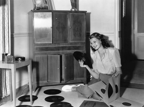 ladylikelady:  Rita Hayworth adds to her record collection- c.1941