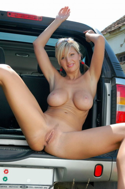 Girl flashing tits car