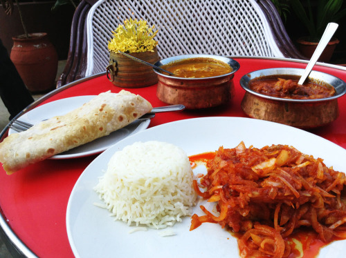 A final trip to Goa with chicken xacuti, pork vindaloo and fish marinated vinegar and chorizo spices served with rice and chapati The vindaloo we commonly find in the West is a neon red, where the color is usually imparted by food coloring. Like most vindaloos, the powerful Kashmiri chilis, the vinegar, and garlic is on the front, followed by the sweet and tender pork elevated by whole cloves. Xacuti is a toasted coconut dish with a coriander and cumin powder forward flavor — this one was garnished with fresh coconut milk, which I find is excellent with toasted coconut. Mustard seeds and curry leaves impart the classic South Indian depth to the braise. The only missing classic Goan dish at the table is a cafreal — which is a deep coriander and mint curry. You always have to leave something to go back for. I like to leave my relationships open ended.  Pondicherry, Tamil Nadu, India