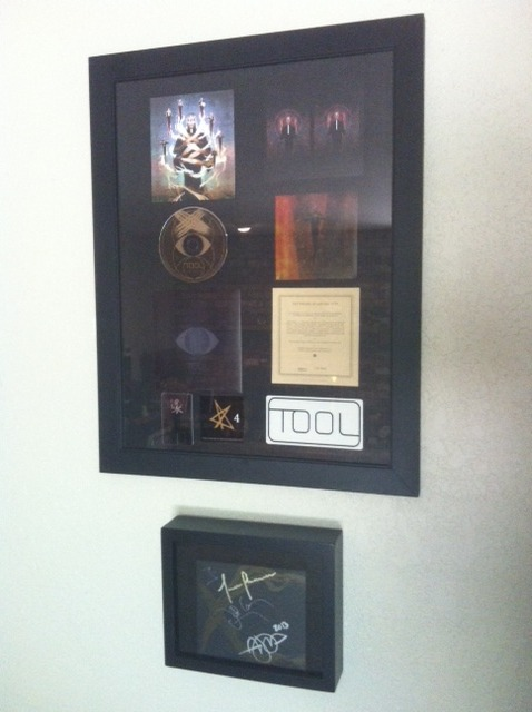 Got my TOOL Opiate reissue framed today,put the autographed jacket in a  shadow box. LOVE!