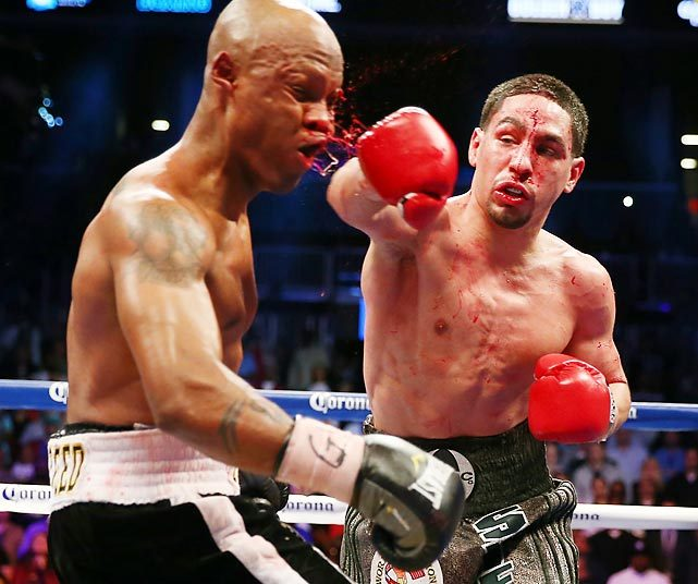 Danny Garcia lands a big hit on Zab Judah under the lights of the Barclay's Center in Brooklyn on his way to winning the WBA Super and WBC Super Lightweight title fight in 12 rounds on April 27. (Elsa/Getty Images) GALLERY: Leading Off - Pictures of the Week