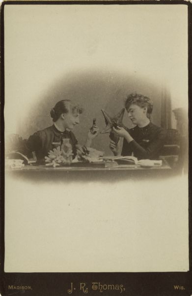 ca. 1860-90's, [cabinet card of two women sitting at a table examining a starfish and other specimens using magnifiers], J.R. Thomas via the Wisconsin Historical Society