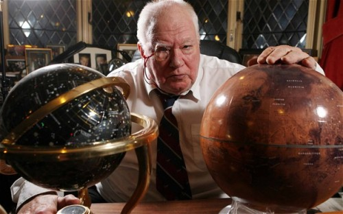 Badass Scientist of the Week: Sir Patrick Moore Sir Patrick Moore (1923–2012) was a self-taught but distinguished British astronomer, famous for his television show The Sky at Night, his eccentric personality, and his occasional xylophone playing. Moore read his first astronomy book at age 6; at 11, he bought his first telescope and became the youngest member of the British Astronomical Association; and at 13, he published and presented his first scientific paper about the Mare Crisium, a crater on the moon. He started wearing a monocle and smoking a pipe at 16, and in this year he also joined the RAF and served from 1940 to 1945, through WWII. During this time he met Orville Wright and Albert Einstein (with whom he played piano), and he also lost fiancé when she was killed in a London air raid. He remained a bachelor for the rest of his life. After the war, he wrote and published his first book, Guide to the Moon, and began to teach and work as an amateur astronomer. He developed a particular interest in the far side of the Moon, and his work mapping its surface was used by the US and Russian space programs. Moore first appeared on television in the 1950s in a debate about the existence of flying saucers, and was soon invited to present his own live astronomy program. The Sky At Night was hugely popular because it appealed to the layman as well as the experts—Moore was known for his imaginative, understandable analogies, such as comparing the Milky Way to a fried egg, and so he undoubtedly inspired a generation of stargazers. He presented the program for over 50 years, right up until his death in 2012, and made the Guinness Book of Records as the longest running TV series with the same presenter, receiving his knighthood in 2001. Amazingly, he believed he was the only person to have met Orville Wright, the first man to fly, Yuri Gagarin, the first man in space, and Neil Armstrong, the first man on the Moon. Moore passed away peacefully at age 89 after being struck down by infection. It was known that he always carried his organ donor card with him, which simply said: 'You can have the lot.'