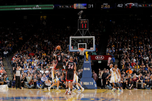 nba:  LeBron James of the Miami Heat makes a shot, passing the 20,000 point career milestone, during a game against the Golden State Warriors on January 16, 2013 at Oracle Arena in Oakland, California. (Photo by Rocky Widner/NBAE via Getty Images)  Bron Bron 20K.
