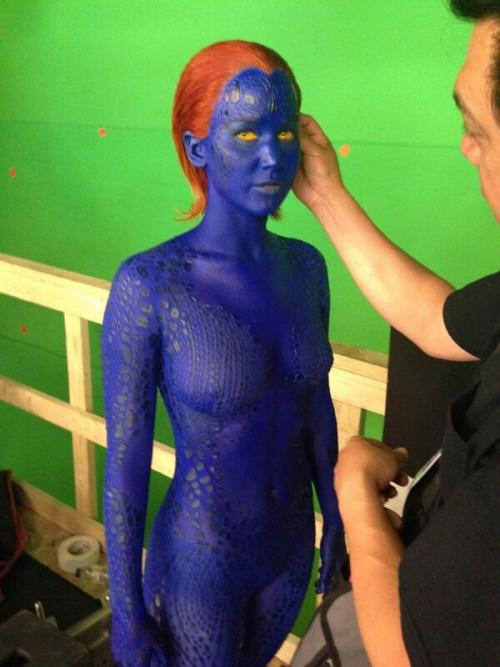 DOFP: Mystique  Bryan Singer has tweeted what he's calling a 'vengeful' Mystique, played by Jennifer Lawrence. So the question is, what does she have to be vengeful about? Going with the comic-canon Mystique… that would be quite a list of true and perceived injustices for her to be miffed about. Going from First Class… she kinda gets what she wants. She goes off with the hot guy to do whatever the heck she wants and seemed to be only moderately sad for leaving her 'brother' Xavier. If anything, old-Mystique from X3 is the one who should be pissed… though will Jennifer be playing her older self as well? Even though Rebecca owned the role in the first X-films, being a shapeshifter, Jennifer could play her old-self, once the cure wore off. Or, is something going to happen (or did happen in the intervening years) which will make Mystique so vengeful? (Please let that involve Kurt… oh please, oh please.) Going from a film/technical perspective. It was reported back in February that Jennifer would forgo the body paint and instead wear a body suit for the role. With the original body paint there was several pieces which were 'glued' on to do the scale effect and to preserve Rebecca and Jennifer's dignity. From this photo, I'm pretty sure it's a body suit as I can see a ridge line at her neck. It looks good, well matched color to the face paint and it's very form fitting. However, Jennifer is standing still at the moment, it will be the action sequences which will be the most telling if this works or not. In any case, I know Jennifer is a big star now, but, dunno, if Rebecca could do the paint three movies in a row, don't see why Jennifer couldn't… of course I'm not an actor so what do I know?  View Post