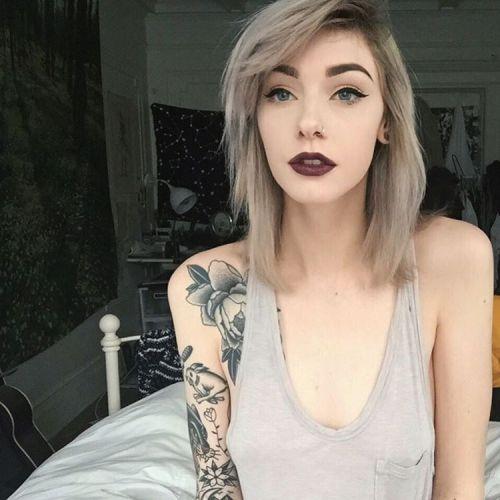 Tattooed pale girl in heels analyzed