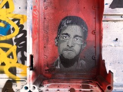 edward-snowden-stencil-led-on-an-old-spy-tower-in