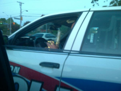 drugsarefunforyou:  shutupburnout:       A friend caught an officer enjoying a nice bong rip on duty  this  yes  Lol they just confiscated that paraphernalia and is taking pictures for the courts, because a stoner was dumb enough to ride around with his bong and get caught, sorry to burst your bubble, my mama had to do the same shit with me in the car back in her NYPD days.  There's def smoke in that bong. Sorry to burst your bubble, but hes getting high as fuck.