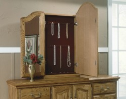 Secret compartment for jewelry behind vanity mirror on dresser