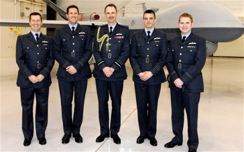 "The Telegraph: The first deskbound drone pilots get their RAF Wings:  Four RAF pilots have made history by becoming the first to be awarded their ""wings"" for flying unmanned aircraft. The newly-qualified airmen will now pilot the Reaper MQ-9 aircraft in missions against the Taliban in Afghanistan, from an office on a US military base more than 7,000 miles away, near Las Vegas. Although the RAF already has drone pilots, the four are the first to be trained specifically to fly unmanned aircraft.>  As the machines cannot currently been flown in the UK, under aviation laws, they trained in the USA, before graduating at Creech Air Force Base in Nevada, USA, last month. The photograph shows RAF Deputy Commander-in-Chief Operations Air Marshal Richard Garwood, centre, with the newly graduated RPAS pilots. Credit: SWNS By Jasper Copping"