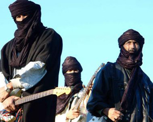 "(via Rising Tuareg Band Terakaft to Perform in London on May 29 | World Music Central.org) ""Terakaft, one of the rising stars in Tuareg music will bring their desert blues sound to Electrowerkz in London on May 29,2013. Comprised of two original members of Tinariwen, the band was formed in 2001 in Kidal (Mali). This Tuareg desert rock band uses droning guitars, pulsating rhythms, and powerful, mournful vocals. Terakaft means 'Caravan' in their mother tongue and they tell tales of a nomadic people, of families displaced, of violence, loss, sadness and defiance…"" Get Kel Tamasheq on iTunes!"