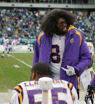 siphotos:  Randy Moss speaks to teammates on the sidelines during a 2004 Vikings game. (Al Tielemans/SI) GALLERY: Rare Photos of Randy Moss