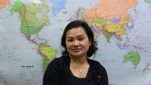 "Simony Ing was born in Cambodia in 1967 and lived there with her family until the age of seven. Her parents sensed the danger of political turmoil when Pol Pot came to power and arranged for her family to leave the country. ""I wasn't aware of the Khmer Rouge because I was so young… My mom was the one who took care of us."" Her father, an educated man and CEO of a Cambodian bank, and her mother, had to pretend to be ignorant, uneducated citizens in order to avoid persecution by the government. Simony's mother and father would tell officials that they were ""uneducated, simple people,"" or farmers. If the officials were to find out the truth, everyone in the family would be killed. Simony's mother paid a man from Vietnam to pretend that the Ings were his family; this helped them escape Cambodia safely into Vietnam where they sought refuge for about one year before moving to France where her parents eventually opened a Chinese restaurant. At the beginning of her time in Vietnam, her family was separated from her father. When her family finally joined him in their new home, everyone felt a sense of relief and comfort. Simony learned French and settled into her new home and Cambodian community. Simony and her family were extremely grateful to have fled Cambodia before the genocide. Thousands of other people were not as lucky. Simony met her husband, also from Cambodia, in France where they married soon after, and quickly made the decision to move to the United States; sponsored by his family who had already settled there. They settled into Providence, Rhode Island, where they have been living ever since. After a few years in Providence, with a child on the way, Simony applied to become a U.S. citizen. Upon arrival Simony, having no English skills, worked in a factory for two years. Discontent with this occupation, she began taking English as a Second Language (ESL) and GED classes at the Genesis Center. After receiving her GED, Simony worked at a non-profit organization for five years as a loan specialist, followed by four years at the bank. She was suddenly diagnosed with breast cancer, where she then spent two years attending chemotherapy and radiation treatments. When asked about her cancer, she proudly exclaimed,  ""I'm a survivor now… that's what they said!""  During the two years that she was being treated for her cancer, Simony worked for the census bureau. Since then, due to the current recession, she has had trouble finding a stable job, and now works as a self-employed interpreter in Cambodian and French. She is happy with her life in Rhode Island where she can provide for her two sons financially, and give them everything they need in order to be successful. Her two sons are doing extremely well in high school and her oldest plans to attend college out of state. When reflecting on the life Simony and her husband have provided for their sons, she claims,  ""My children, they have everything. So we provide them with everything. They don't have anything missing like us. From generation to generation, they have more choice than us.""  Although she misses her family in France, she enjoys the cheaper cost of living in Rhode Island. Simony loves to travel and often embarks on road trips with her family throughout the whole country. Due to Simony's desire to travel, she will be going to Cambodia this summer for the first time since she left her home country.  She will be traveling with other family members but her husband will not be taking part in the trip due to his personal memories of living through the genocide under the Khmer Rouge; he has no interest in ever returning to the country. For many, the genocide was a traumatizing period; Simony stated.  ""A lot of sad things happened during the Khmer Rouge… I heard a lot of sad stories… We left before the war; we were lucky.""  In order to stay connected to their Cambodian roots, Simony and her family participate in Cambodian events in Providence's three Cambodian temples, her favorite being the Cambodian New Year. She attends large events every couple of months, enjoying the fun social events and good food. Simony and people in her community have experienced some discrimination in Rhode Island, but nothing that severely damaged their sense of self. Simony is content with her life in Rhode Island and is excited about what the future will hold for her and her family. When asked if she could change anything about her past she responded, ""No, I'm happy with my journey.""  Written and Compiled By Maddie Mylod and Natalie Wingate"