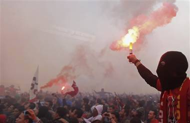 breakingnews:  At least 30 dead in clashes over verdict in Egypt soccer riots Reuters: Clashes in Egypt's Port Said killed at least 30 people Saturday, including two soccer players. The riots erupted after a judge sentenced 21 people to death for a February 2012 soccer fight which killed 74 fans cheering for Cairo's Al-Ahly team. After the ruling, residents in Port Said tried to storm the city's prison and free the defendants in the case.  The clashes follow violence brought on by anger at Egyptian President Morsi on Friday, the two-year anniversary of the 2011 Egyptian Revolution. Nine people died in those clashes, bringing the total from both outbursts to 39. Photo: Al Ahly fans, also known as 'Ultras,' celebrate and shout slogans in front of the Al Ahly club after hearing the final verdict of the 2012 Port Said massacre in Cairo Saturday. (Amr Abdallah Dalsh / Reuters)  While apparently our death toll figures culled from initial reports of this terrible riot last year ran a bit high, it still turned out as be over seventy fans left dead in a brutal melee. Now, the aftermath of that grisly scene has spawned its own fatal encounter.